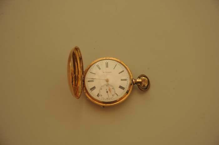sold,Antique gold clock